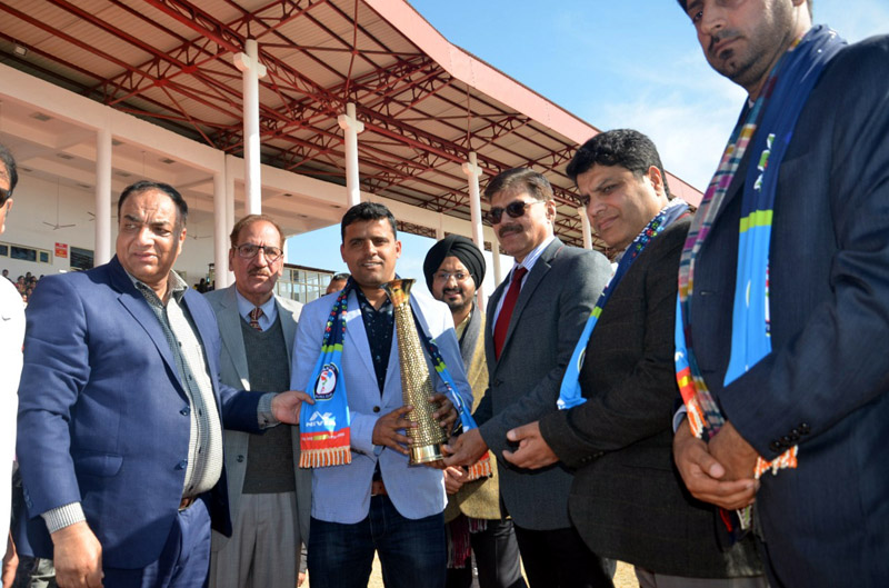 Advisor K Vijay Kumar honouring ace Footballer Arun Malhotra in presence of other dignitaries at Katra on Monday.