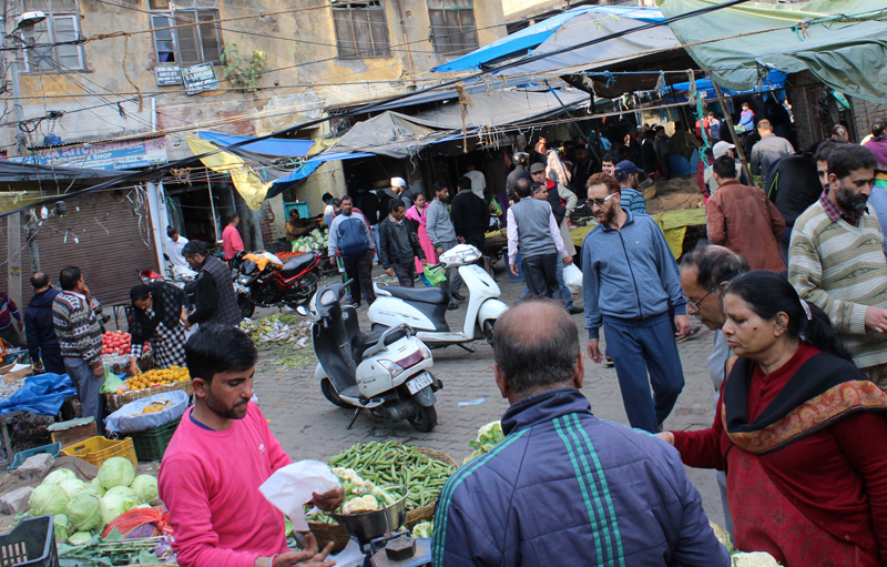 People purchasing vegetables in Jammu City on Tuesday. -Excelsior/Rakesh
