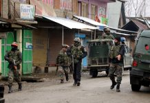 Security forces during encounter in Warpora, Sopore on Friday.