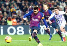Barcelona's Argentinian forward Lionel Messi shots a penalty kick during Spanish League football match against Real Valladolid.