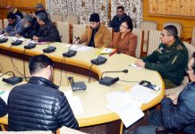 Divisional Commissioner Kashmir Baseer Ahmad Khan chairing a meeting on Saturday.