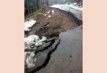 A large portion of highway sinks near Kud on Friday.