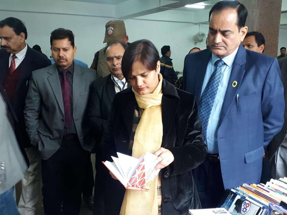 DSEJ Anuradha Gupta going through a book displayed at annual book fair on Friday.