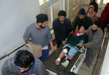 An injured student being shifted to SMHS hospital on Wednesday. —Excelsior/Shakeel