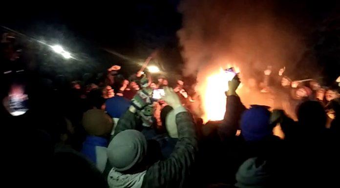 People protesting at Pashkum in Kargil on Monday evening. -Excelsior/Basharat Ladakhi