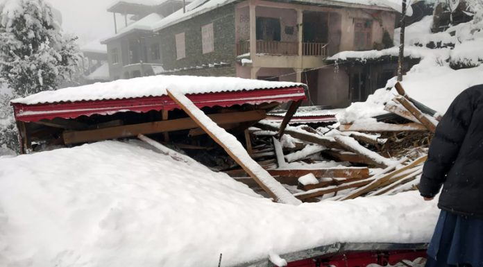 A tripple-storey house collapsed due to rain and heavy snowfall in Bhalessa area of Bhaderwah. -Excelsior/Rafi Choudhary