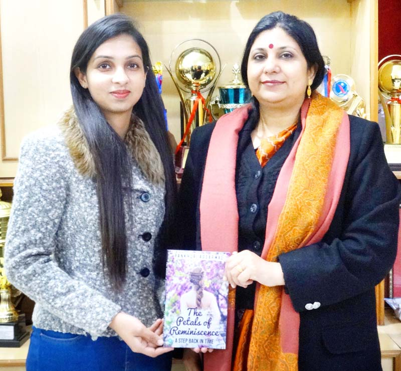 Pankhuri Agarwal displaying her newly published Book.