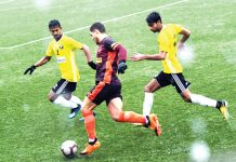 Players in action being during I-Leagues match between Real Kashmir and Gokulam Kerala played under snow and rain in Srinagar. -Excelsior/Shakeel