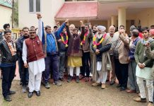Ch Lal Singh with his supporters at Sunderbani on Thursday.