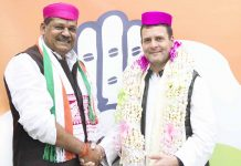 Former Cricketer and BJP MP Kirti Azad who joined the Congress party being received by Congress President Rahul Gandhi at AICC headquarters, in New Delhi on Monday. (UNI)
