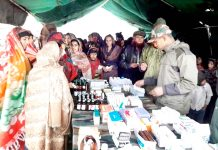 Patients getting medicines at a medical camp in Rajouri on Friday.
