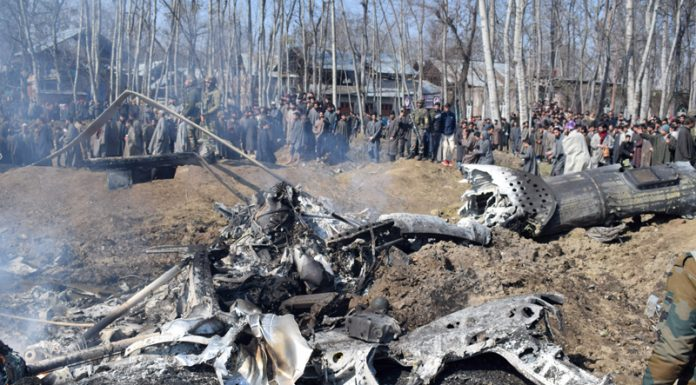 Wreckage of MI-17 lying at the site of crash in Budgam on Wednesday. —Excelsior/Shakeel