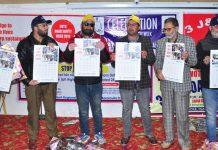 Dignitaries unveiling MVD Baramulla wall calendar. —Excelsior/Aabid Nabi