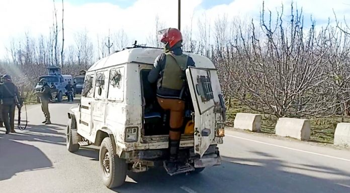 Troops at the site of encounter at Turigam, Kulgam on Sunday. -Excelsior/Sajad Dar