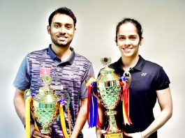 Saina Nehwal and Sourabh Verma with their trophies at the 83rd Senior National Badminton Championship in Guwahati on Saturday.