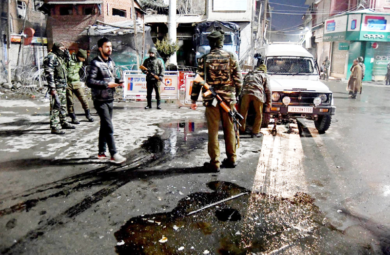 Security forces alert after grenade attack at Palladium cinema lane in Lal Chowk, Srinagar on Sunday. —Excelsior/Shakeel