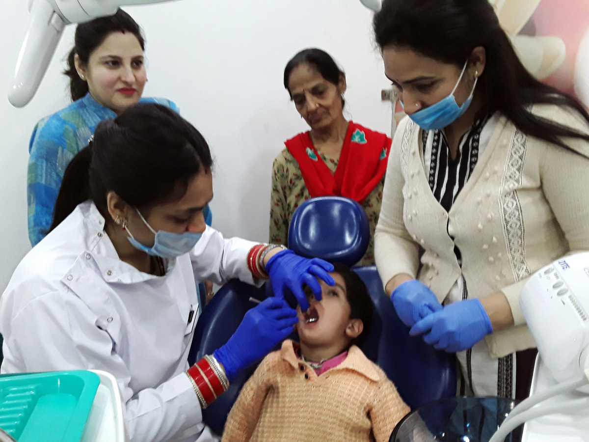 Doctors examining a patient at a medical camp in Jammu on Sunday.