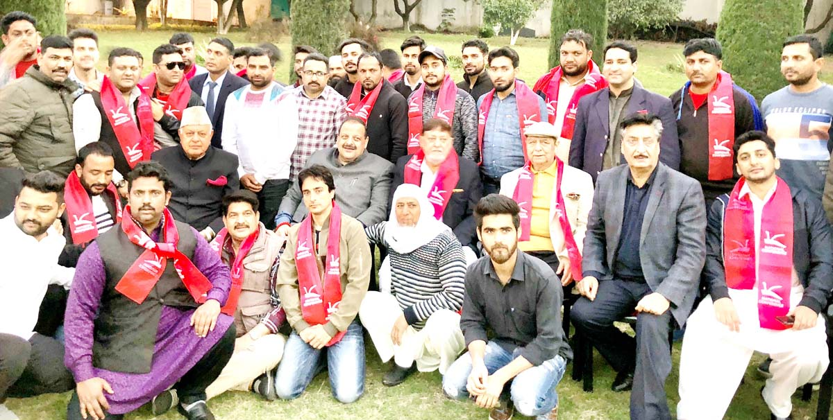 NC president, Dr Farooq Abdullah and other senior party leaders posing with new entrants at Jammu.