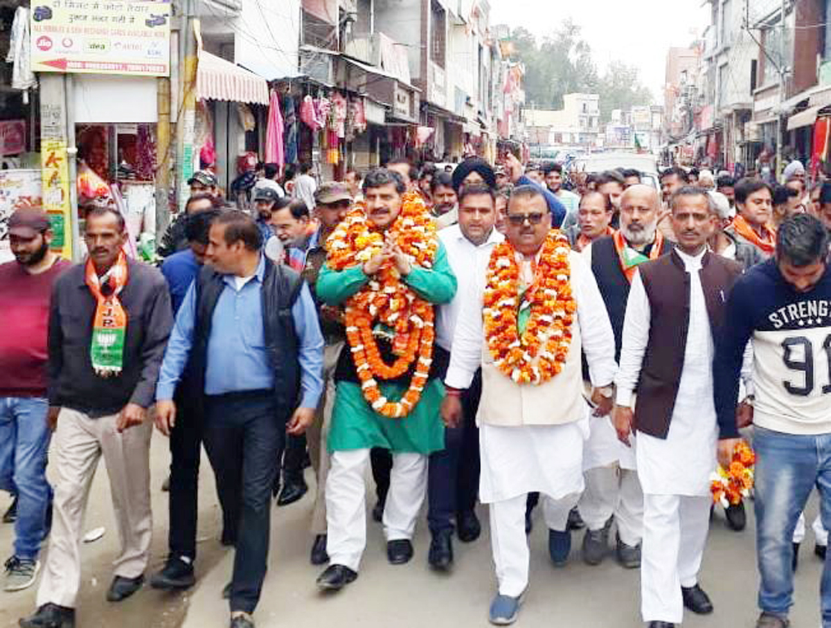 MP Jugal Kishore Sharma along with former Minister, Chander Prakash Ganga during campaigning in Vijaypur on Sunday.