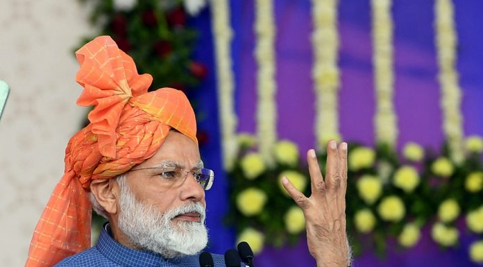 Prime Minister Narendra Modi addressing a function in Gujarat on Tuesday.