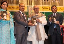 Eminent poet Gulzar alongwith Advisor to Governor and JU VC releasing a book during inaugural of Golden Jubilee celebration of JU on Tuesday. —Excelsior/Rakesh