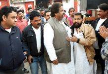 Senior Cong leader, Raman Bhalla interacting with people at Bahu Fort on Tuesday.