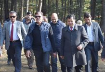 Advisor K Vijay Kumar flanked by officials inspecting Wular Lake Conservation Project on Tuesday.