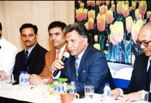 Advisor Khurshid Ahmad Ganai addressing 'Tourism Conclave' at Mumbai on Tuesday.