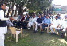 Former Minister & NC leader Surjit Singh Slathia addressing a meeting at Vijaypur on Tuesday.