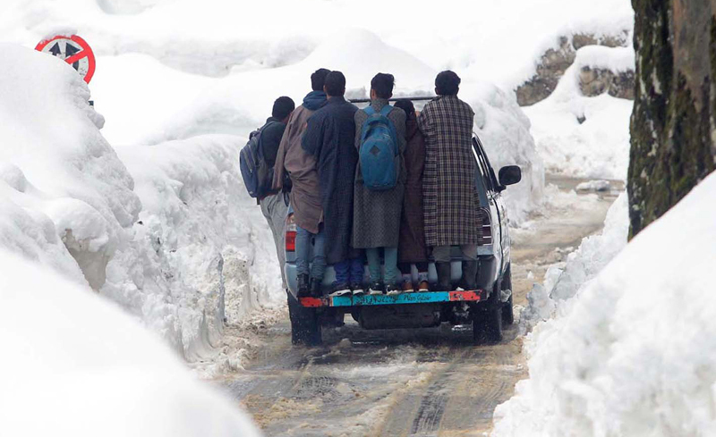 Students risk their lives while travelling to school in a Tavera vehicle in Betab Valley of Pahalgam. —Excelsior/Sajad Dar