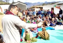 Spokesperson J&K BJP RS Pathania addressing people during interaction camps at Ramnagar.