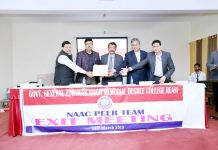 NAAC peer team chairman handing over the college report to Principal of GDC Reasi.