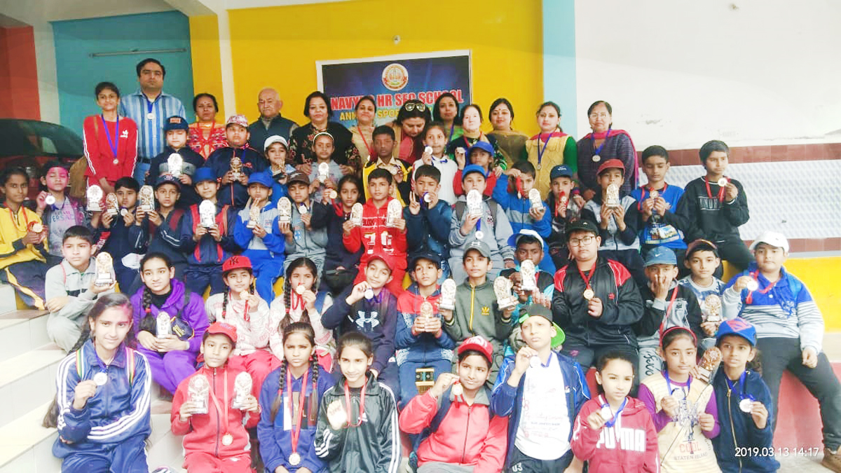 Children posing for a group photograph during Annual Sports Day at Nav Yug HSS in Jammu.