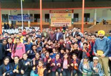 Athletes posing along with IGP Danesh Rana and other dignitaries during concluding ceremony of 17th State Athletics C'ship in Jammu.