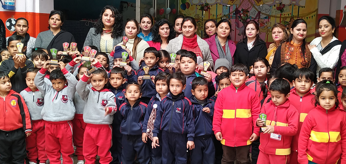 Winners of Inter School competition posing for a group photograph at JK Montessorie School in Jammu.