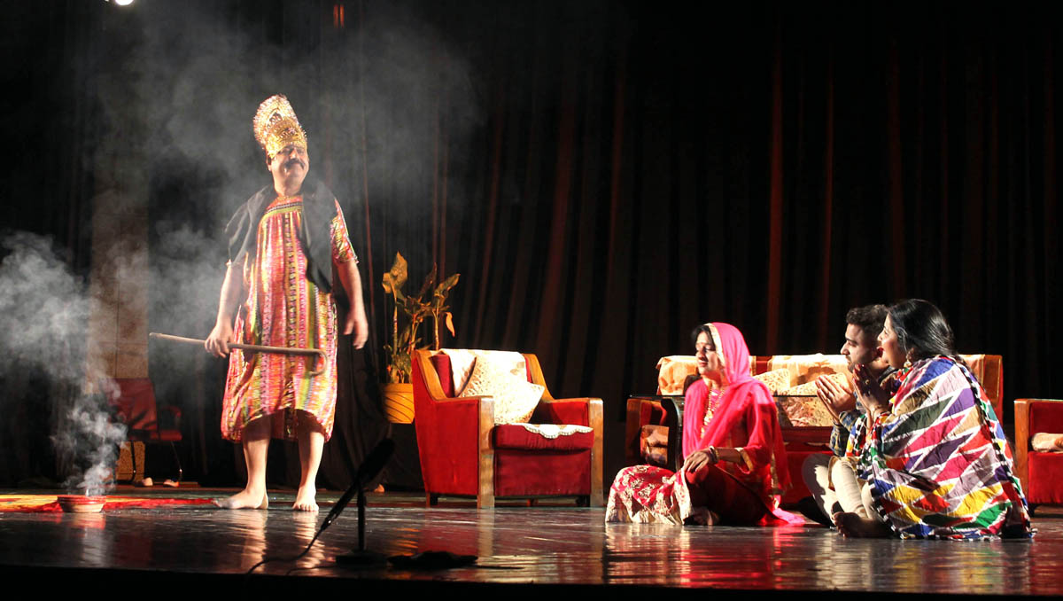 A scene from the play 'Apne Upper Bhari' staged on Saturday. -Excelsior/Rakesh
