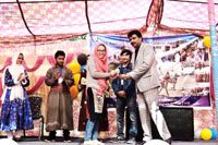 Students being felicitated during annual day function of All Kargil Ladakh Students Association at JK House Chandigarh.