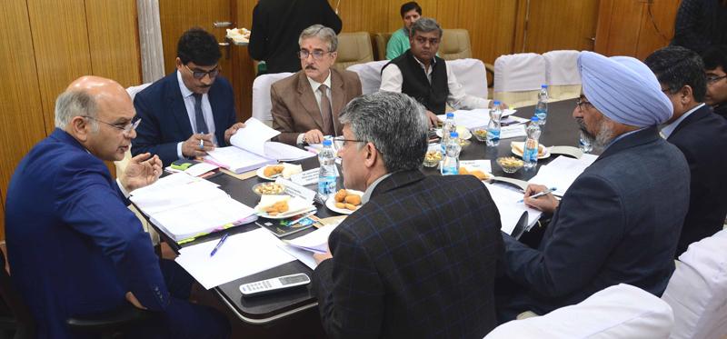 Advisor K K Sharma chairing a meeting in Jammu on Thursday.