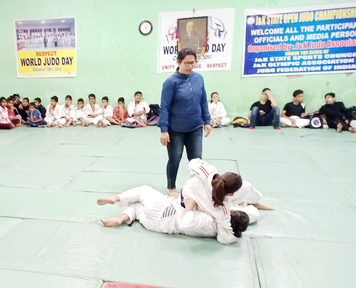 Judokas in action in State Open Judo Championship in Jammu.