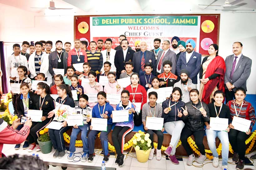 Shooters posing along with the chief guest and other dignitaries during the concluding ceremony of 9th J&K Rifle Shooting Championship.