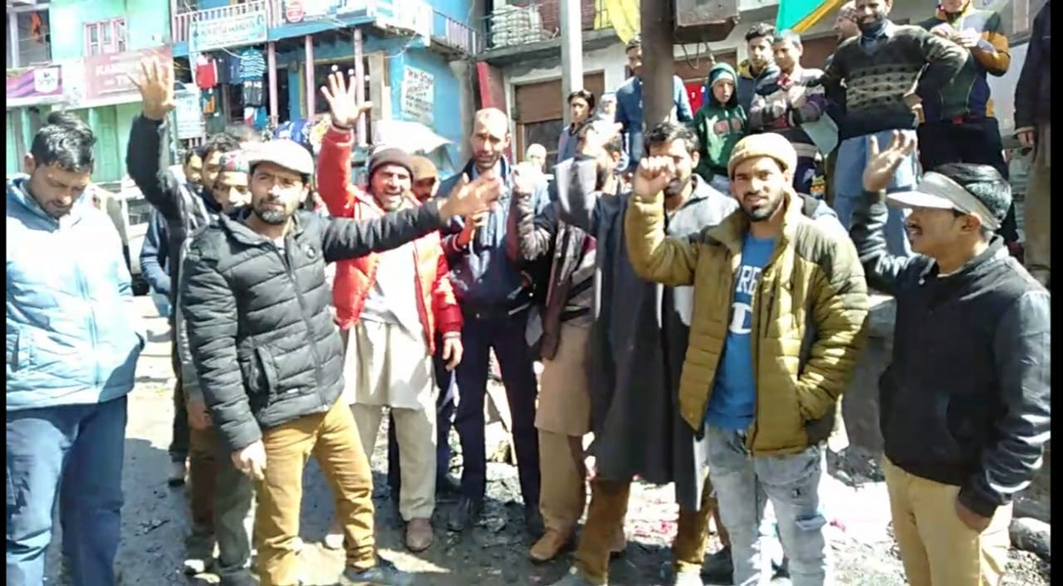 Shopkeepers raising slogans during protest at bus stand Gandoh in District Doda. -Excelsior/Rafi Choudhary