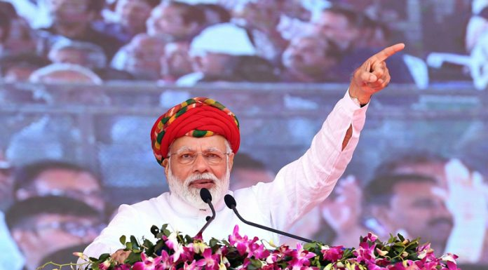 Prime Minister Narendra Modi addressing at the inauguration of various development projects in Jamnagar, Gujarat on Monday. (UNI)