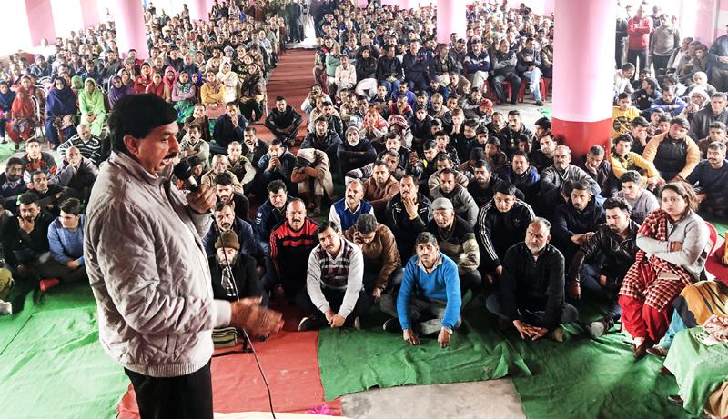 Pawan Gupta addressing locals of Jib-Thathi during a celebration rally on Monday.