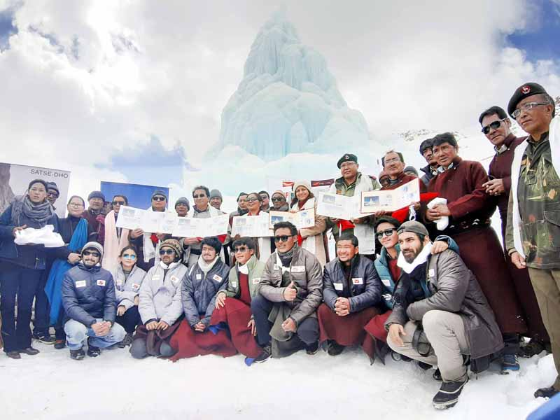 Chief Postmaster General PD Tshering, HIAL Founder Sonam Wangchuk releasing special cover on Ice Stupa at Leh. -Excelsior/ Morup Stanzin
