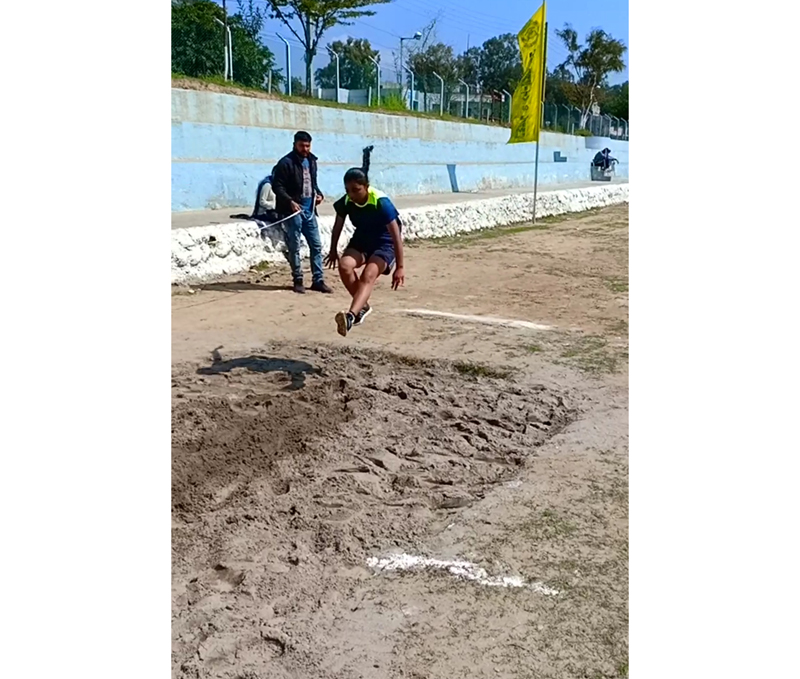 Athlete in action during a long jump match at Jammu University on Tuesday.