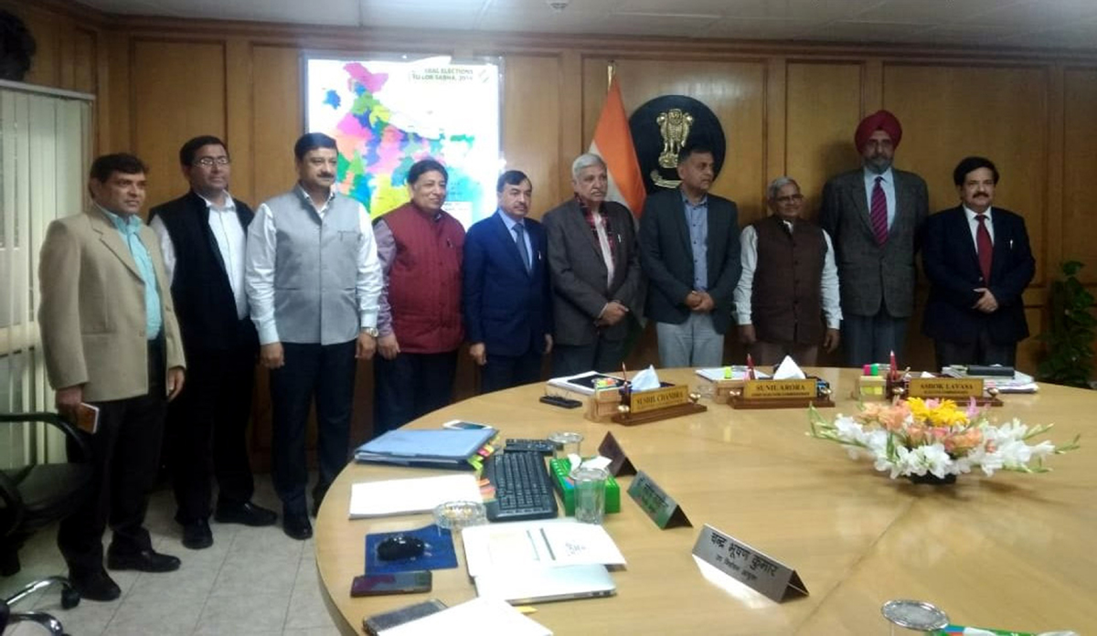 CEC Sunil Arora and other Election Commission officials with three Special Observers for J&K, in New Delhi on Tuesday.