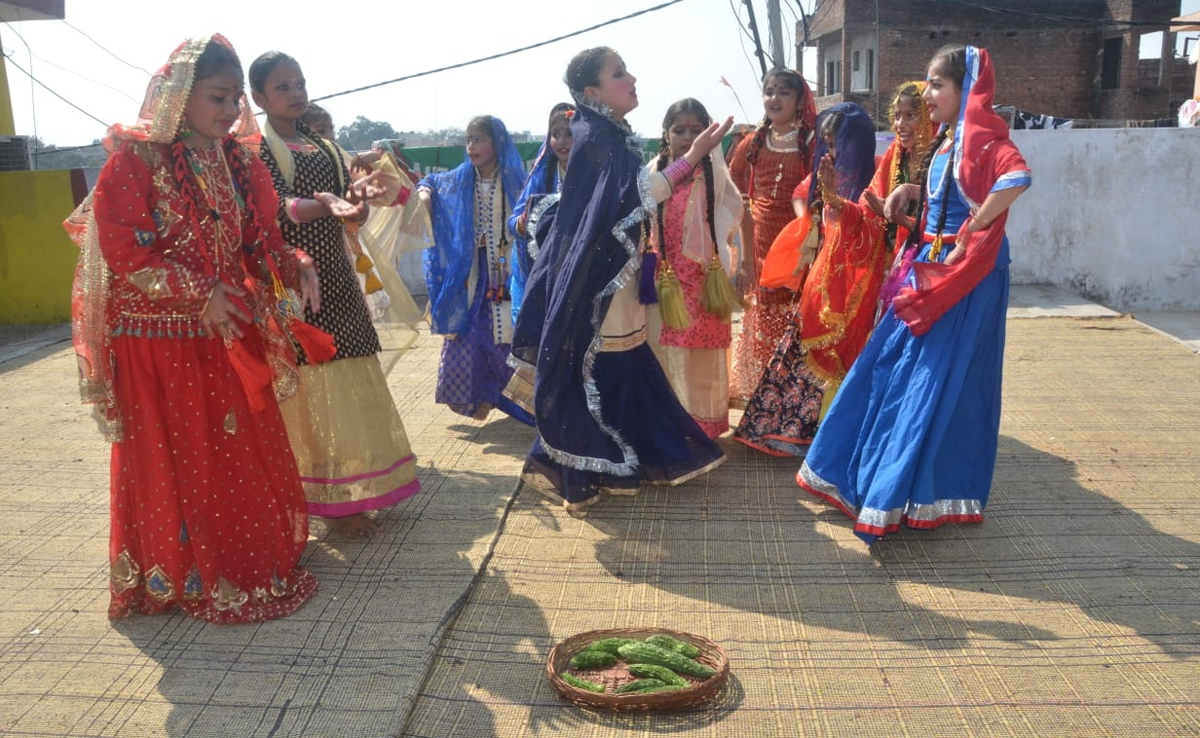 Students in colourful attires presenting a dancing item on Annual Day at New Era School in Jammu