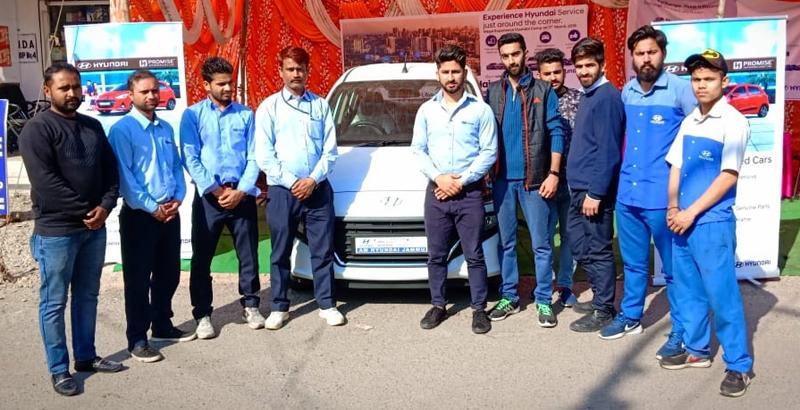 Officials of AM Hyundai posing during 'Experience Hyundai' camp at New Plot in Jammu.