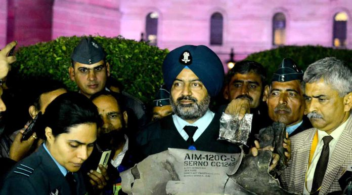 Maj Gen Surinder Singh Mahal, Rear Admiral D S Gujral and Air Vice Marshal RGK Kapoor displaying the wreckage of F16 of Pakistan Air Force, which was shot down in Indian territory, during press briefing at South Block lawn in New Delhi on Thursday. (UNI)