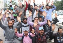 Casual labourers protesting outside Divisional Commissioner's office in Jammu on Tuesday. —Excelsior/Rakesh